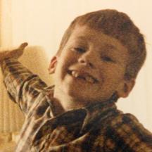 A young, grinning, toothless Ryan.