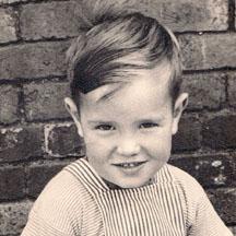 Kid Mick rambunctiously grinning.