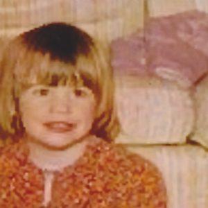 Kid Megan, smiling.