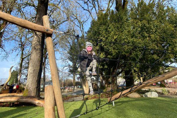 Kid playing at Anna & Abby's Yard